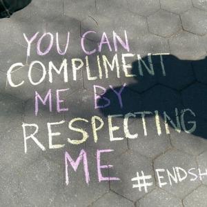 Slogan written in chalk on sidewalk protesting street harassment (Courtesy of Hollaback!)