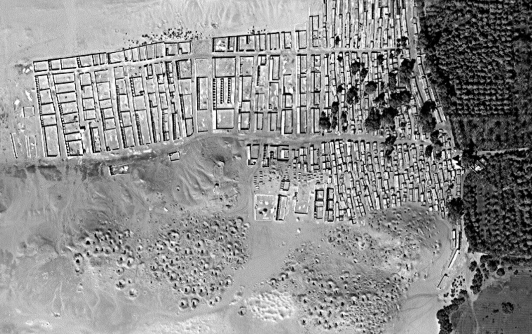Satellite image of city near river (Courtesy of Sarah Parcak)