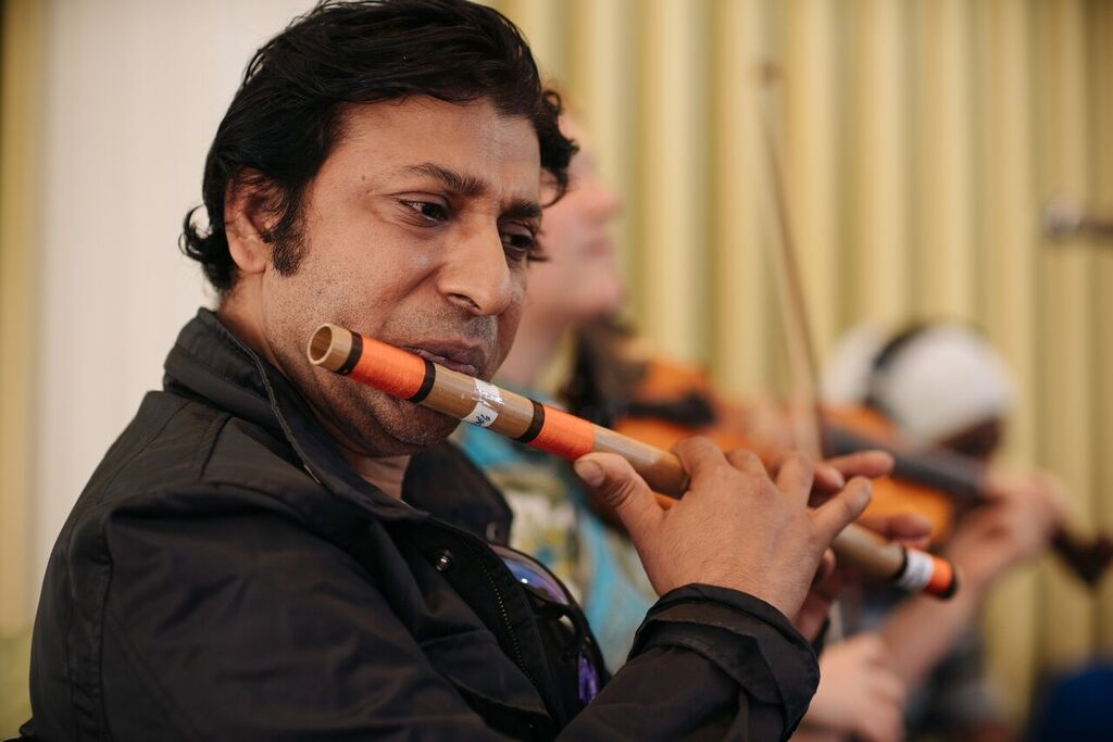 Man playing flute (Courtesy of Dosti Music Project)