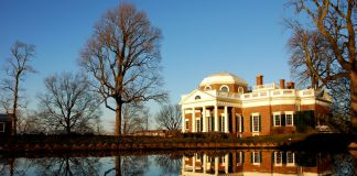 Brick mansion reflecting in pond (Csetzer/Creative Commons)