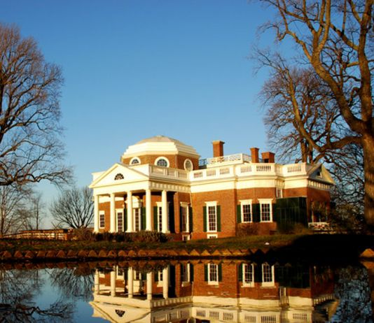 Brick mansion reflecting in pond (Csetzer/Creative Commons)