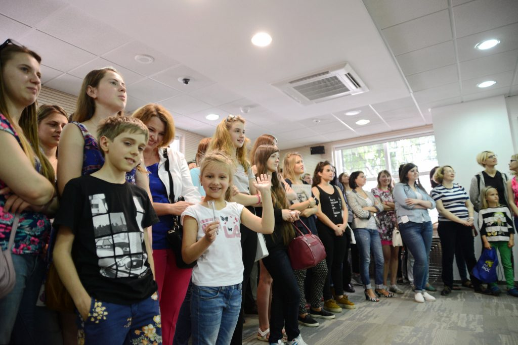 Group of people standing inside room and listening (U.S. Embassy Kyiv)