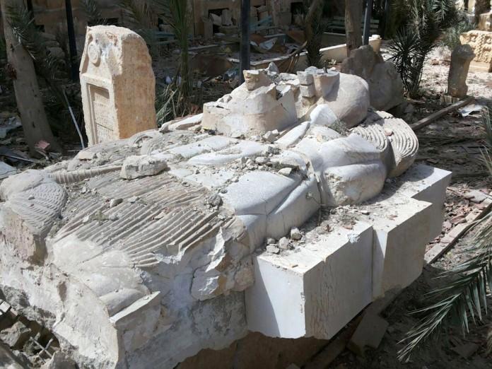 Statue amid ruins (© AP Images)