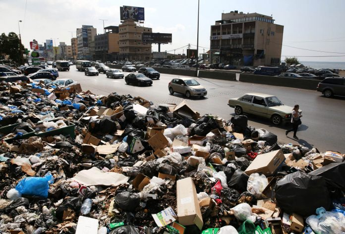Trash overflowing into streets in Lebanon (©AP Images)