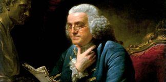صورة زيتية لبنجامين فرانكلين جالسا على مكتبه وهو يقرأ. (White House Historical Association)