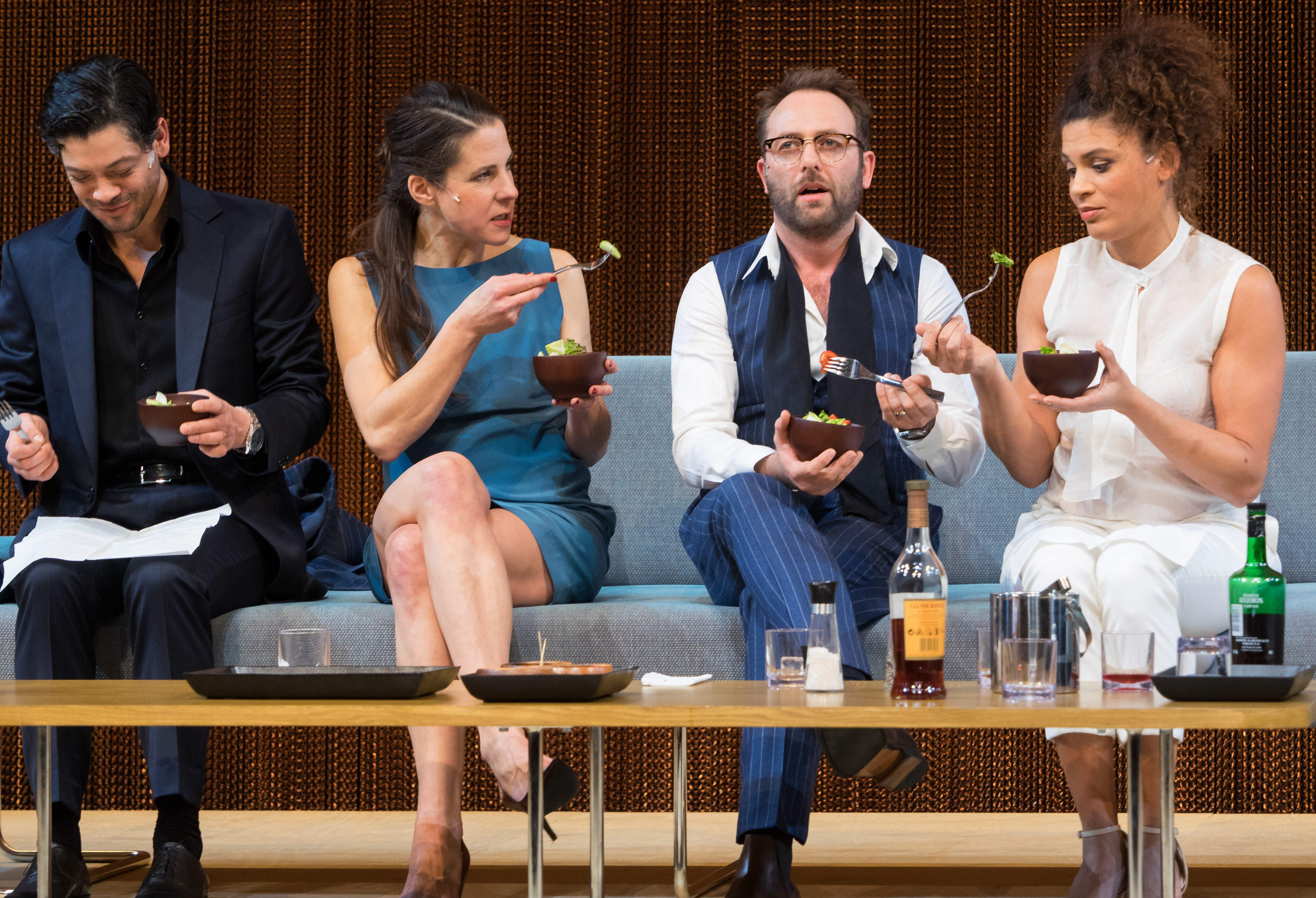 Four actors sitting on couch onstage (© dpa picture alliance/Alamy Stock Photo)