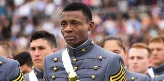 Alix Schoelcher Idrache standing in formation and crying (DOD/U.S. Army Staff Sergeant Vito T. Bryant)