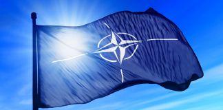 NATO flag waving (Shutterstock)