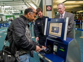 Man scanning his passport using a kiosk (U.S. Customs and Border Protection)