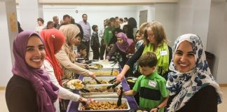 Muslims and non-Muslims sharing meal (Courtesy of MAS Minnesota)