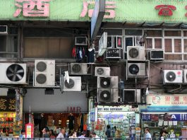 Rows of air conditioners attached to exterior walls (Flickr/Niall Kennedy)