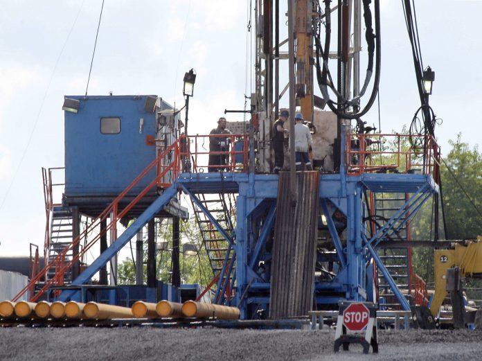 Workers on drilling platform (© AP Images)