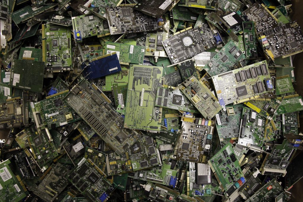 Pile of circuit boards and other internal computer hardware (© AP Images)