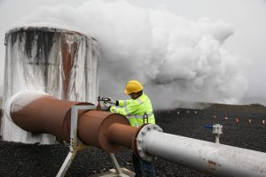 Man checking valve at well (© AP Images)