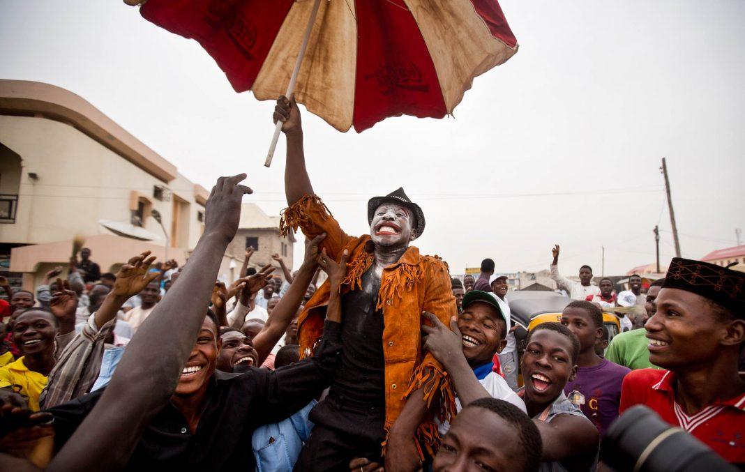 People celebrating in Nigeria (© AP Images)