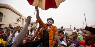 People celebrating in Nigeria (© AP Images)