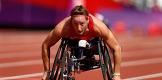 Woman racing in wheelchair (© AP Images)