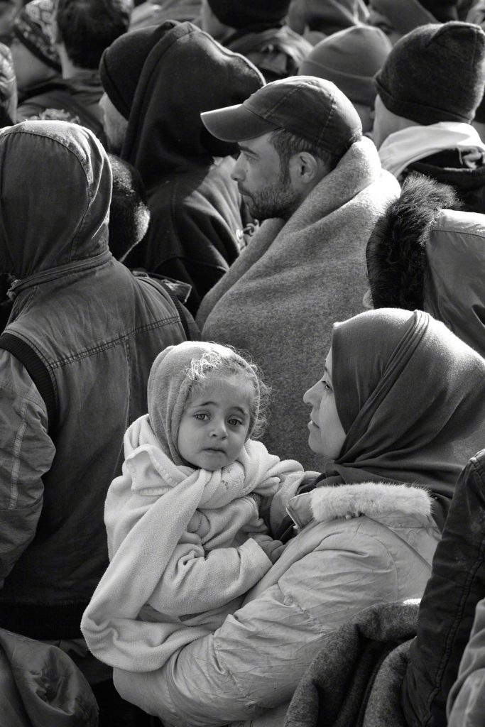 Woman holding baby in crowd (© Tom Stoddart/Getty Images/Courtesy of Annenberg Space for Photography)