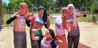 Refugee girls posing (@REFGotTalent/Twitter)