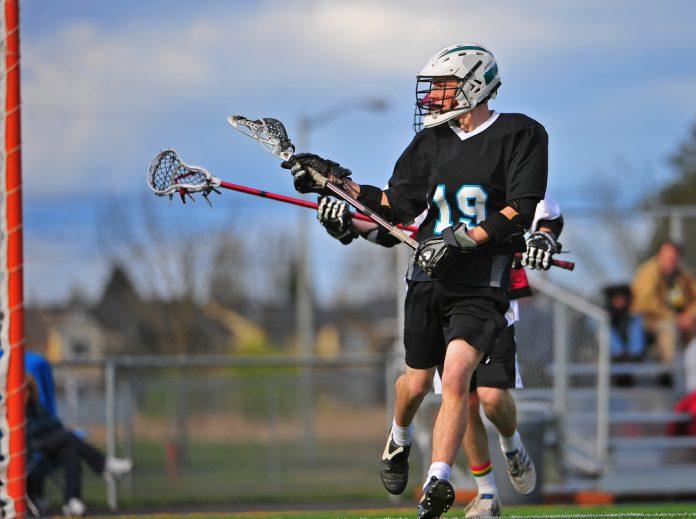 Lacrosse player (© Shutterstock/James A. Boardman)