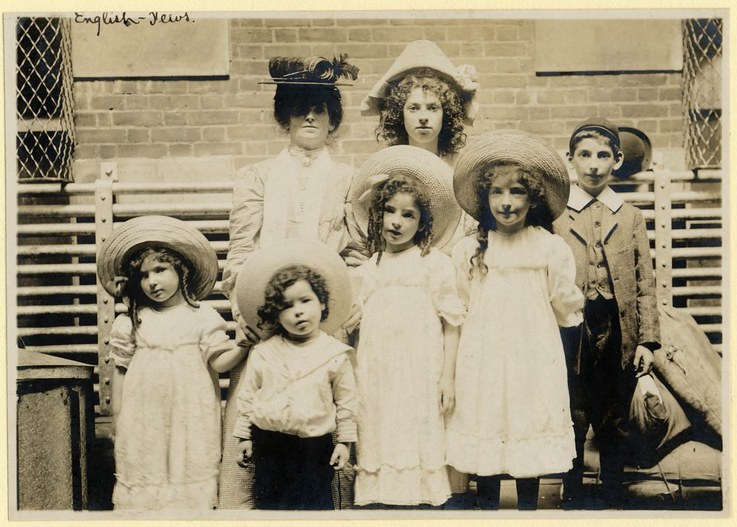 Four young girls, two young boys and a woman in period clothing (NPS Photo)