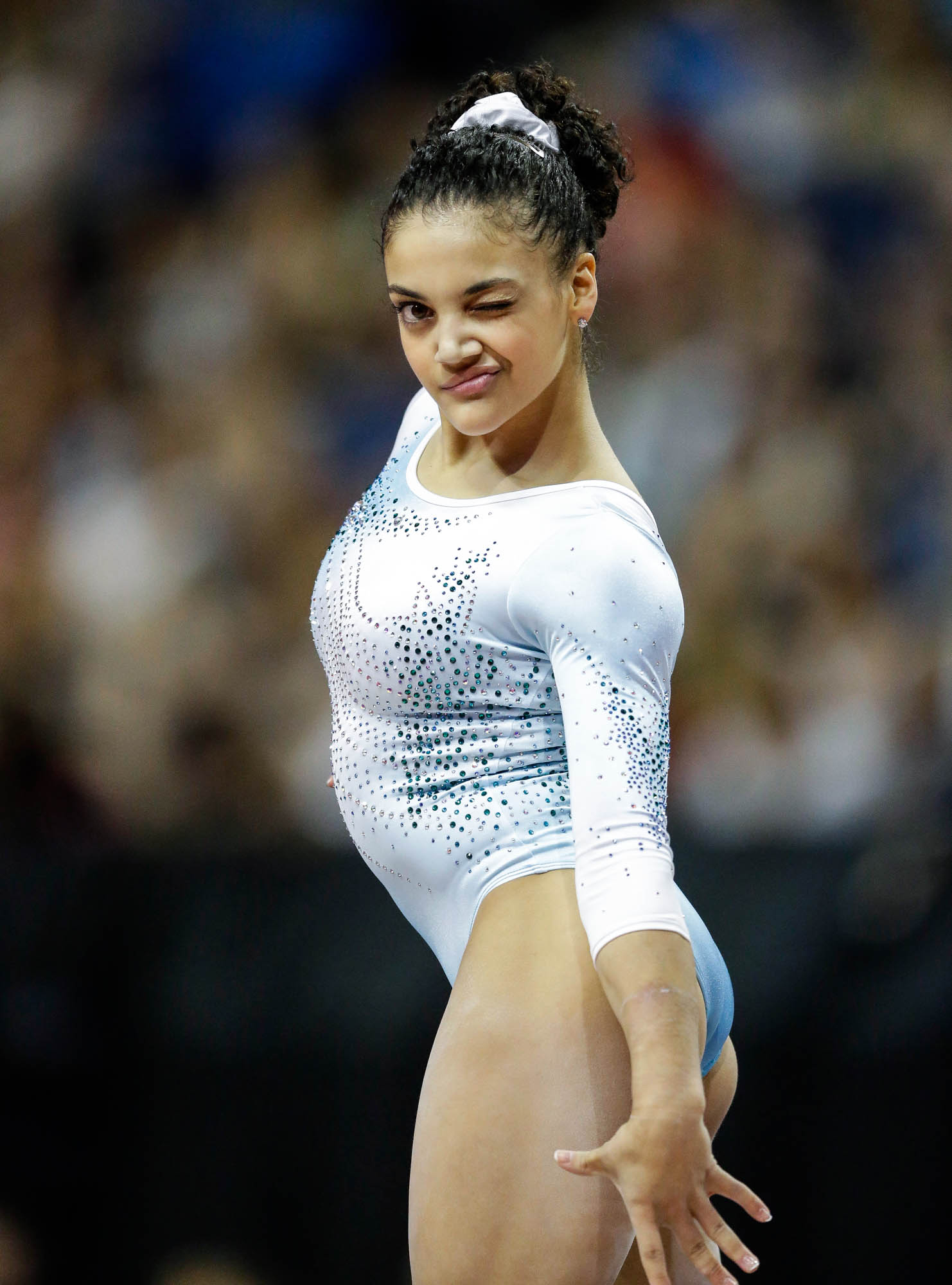 Laurie Hernandez winking during floor routine (© AP Images)