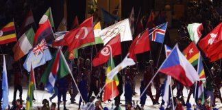 Flags at London Olympics closing ceremony (© AP Images)