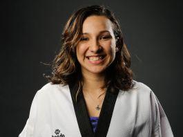 Jackie Galloway wearing judo gear, smiling (© AP Images)