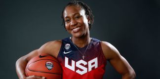 Portrait of Tamika Catchings holding basketball (© AP Images)