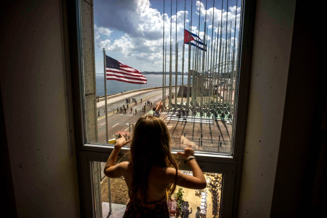 Girl looking out window (© AP Images)