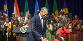 President Obama shaking hands with Grace Jerry (State Dept./D.A. Peterson