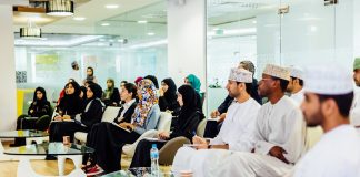 Young Omanis listening to lecture (State Dept.)