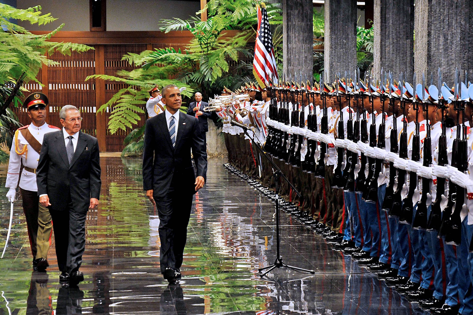 Raul Castro and Barack Obama walking past a line of military personnel (AFP/Getty)