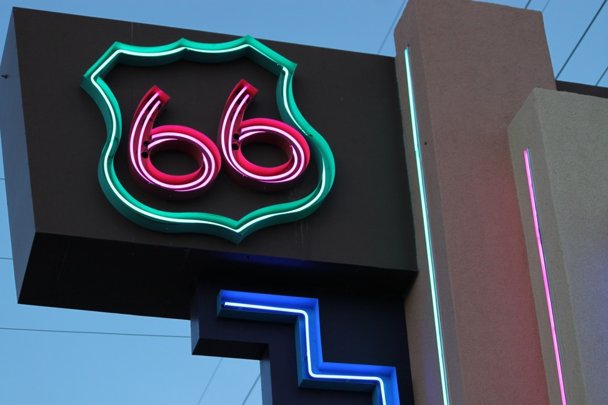 """Red, green and blue neon sign reading """"66"""" (© AP Images)"""