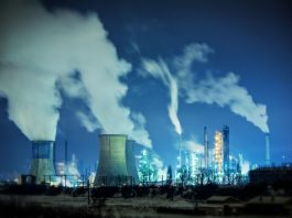 Power plant smokestacks emitting carbon dioxide and other greenhouse gases (Shutterstock)