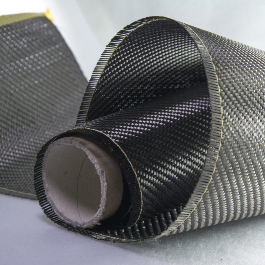 Black roll of industrial fabric unraveling (Shutterstock)