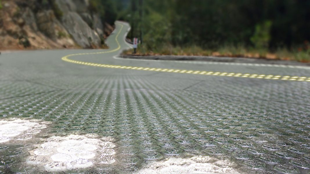 Artist's rendition of solar roadway, with lights glowing in foreground panels (Courtesy of Solar Roadways)