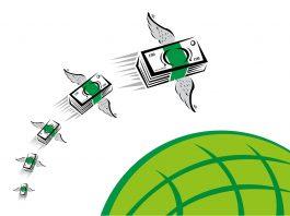 Pilhas de dinheiro com asas voando sobre o globo (Shutterstock)