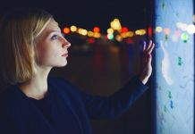 Woman touching digital map (Shutterstock)