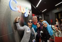 Girls standing in front of Google sign (TechGirls/State Dept.)
