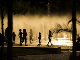 Children playing in fountain (© AP Images)