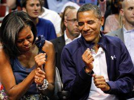 Michelle Obama and Barack Obama dancing (© AP Images)