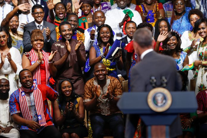 President Obama looking into a crowd of young African leaders (© AP Images)