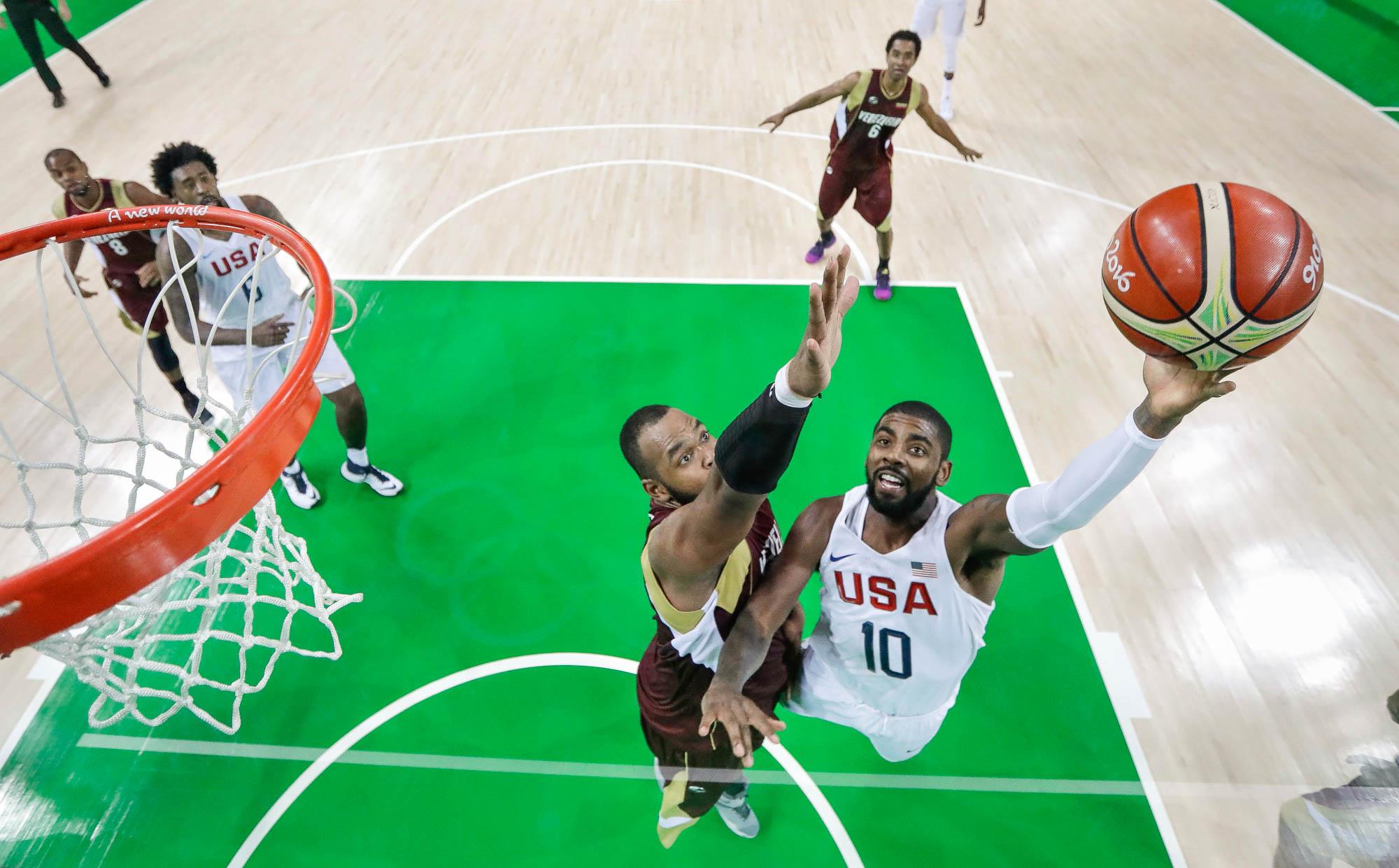 Men playing basketball (© AP Images)