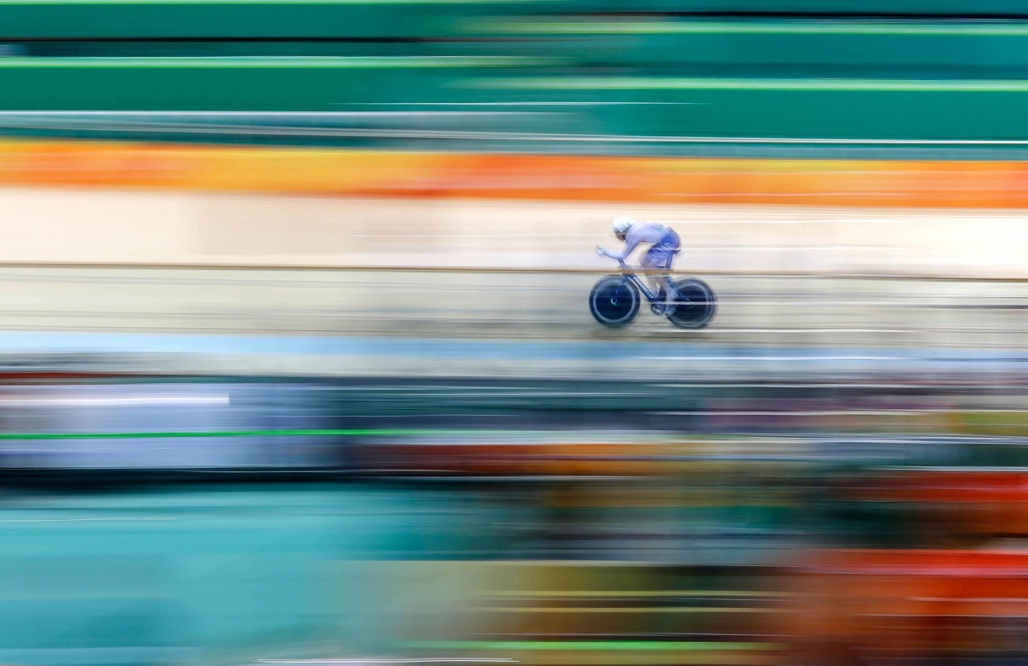 Bike rider moving fast (© AP Images)