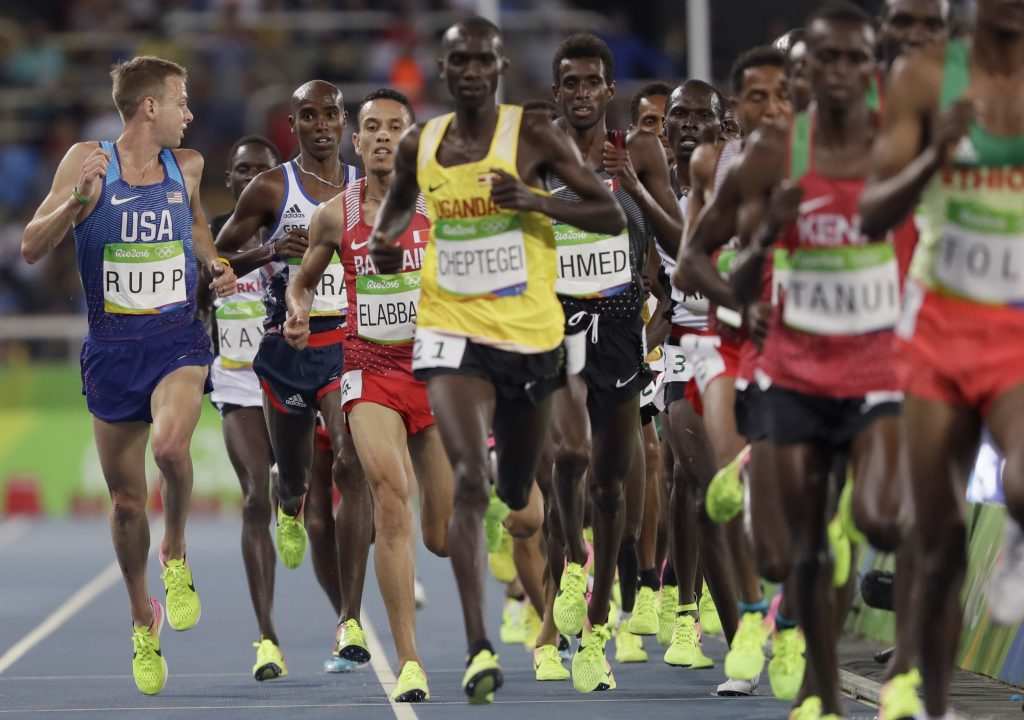 Men running in race (© AP Images)