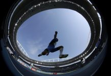 Athlete jumping (© AP Images)