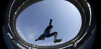 Athlete jumping (© AP Images)