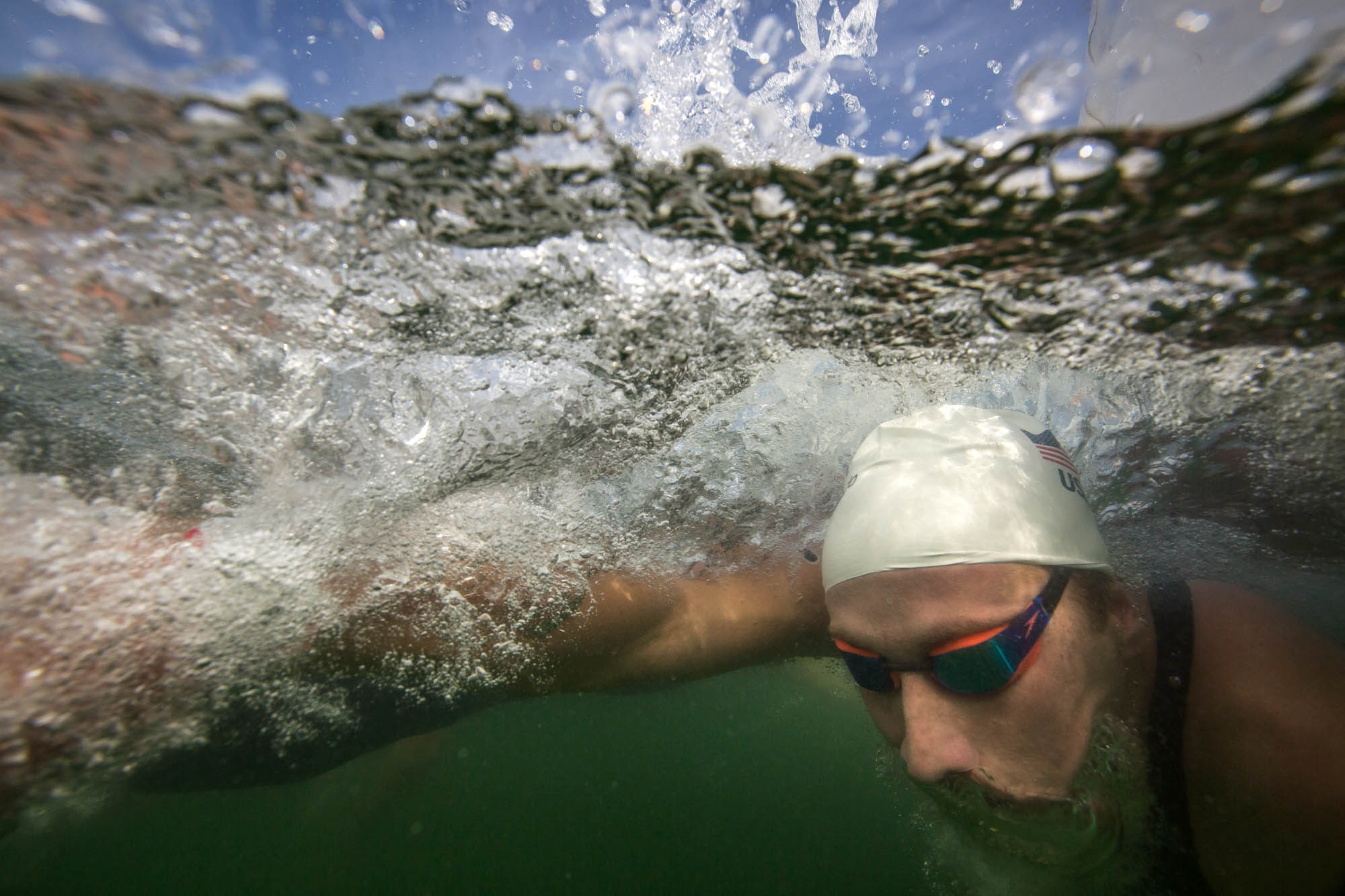 Underwater view of man swimming (© AP Images)