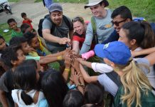 People joining hands (Courtesy of EWB USA)